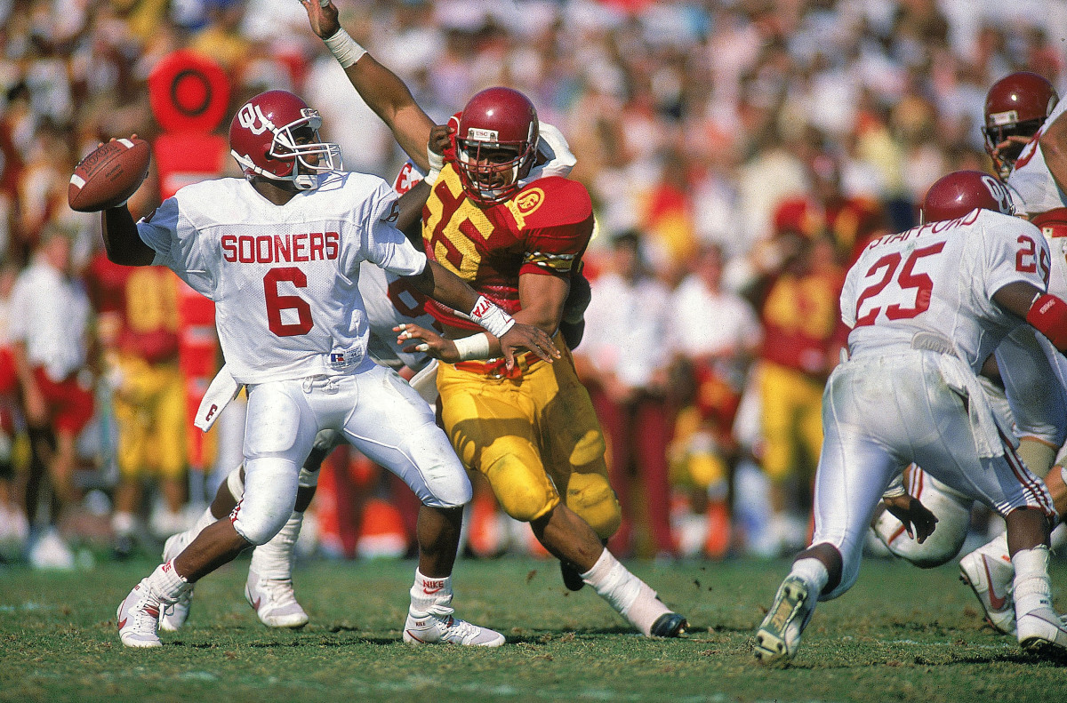 Seau gets after quarterback Charles Thompson in a USC upset of Oklahoma, in 1988.
