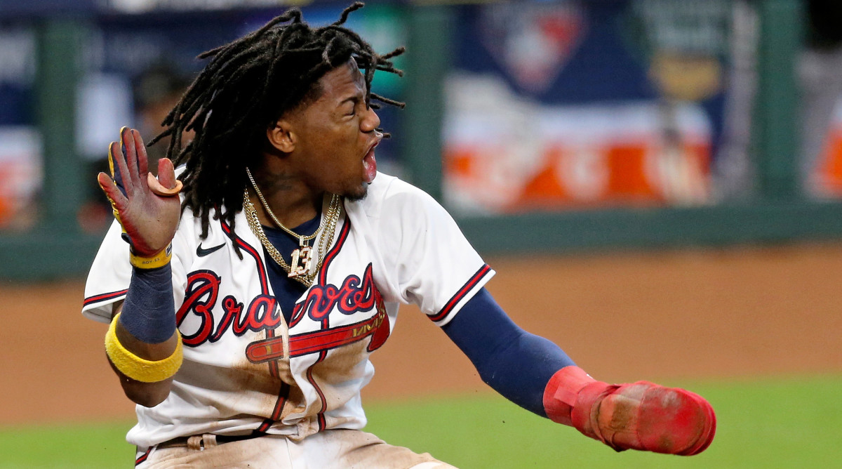 Oct 6, 2020; Houston, Texas, USA; Atlanta Braves center fielder Ronald Acuna Jr. (13) celebrates after scoring a run the 3rd inning against the Miami Marlins during game one of the 2020 NLDS at Minute Maid Park.