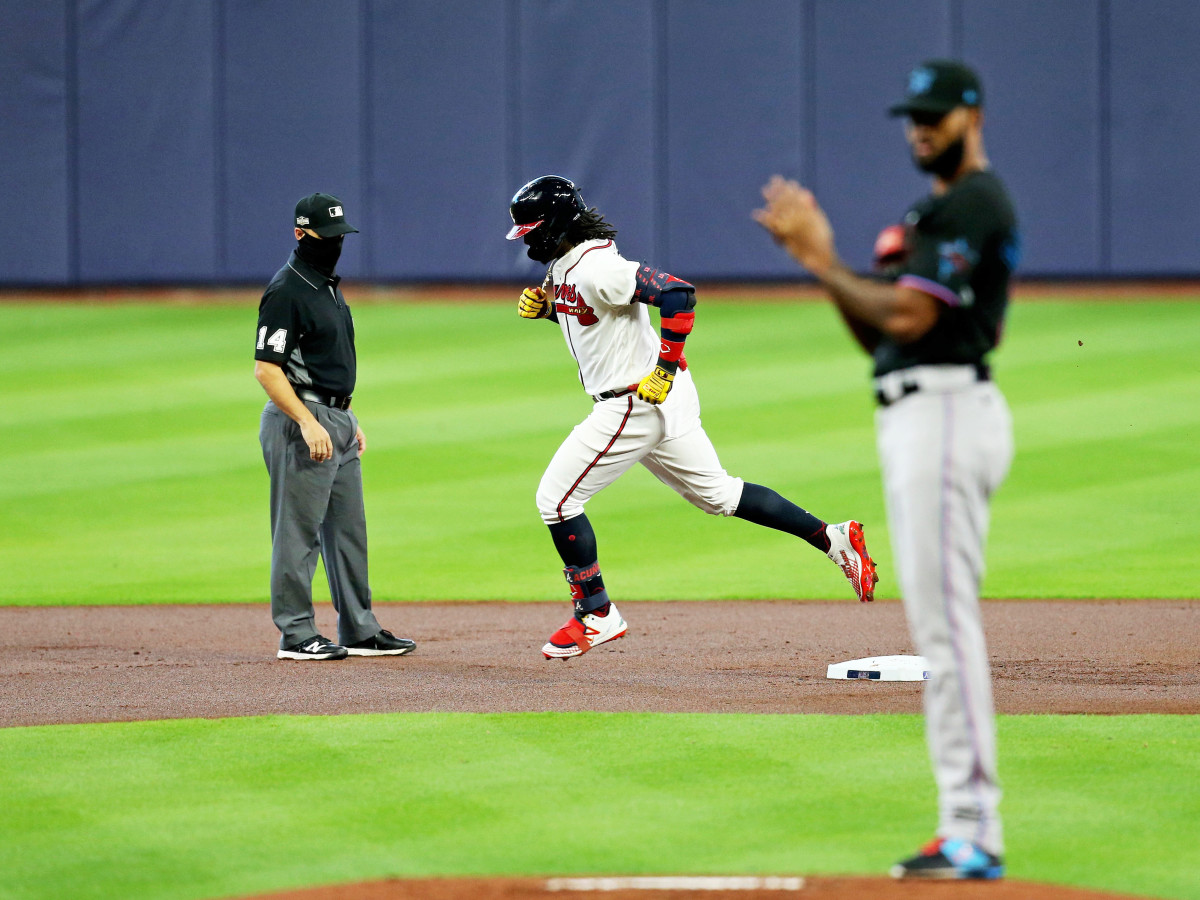 Oct 6, 2020; Houston, Texas, USA; Atlanta Braves center fielder Ronald Acuna Jr. (13) rounds the bases after hitting a solo homerun in the 1st inning off of Miami Marlins starting pitcher Sandy Alcantara (22) during game one of the 2020 NLDS at Minute Maid Park.