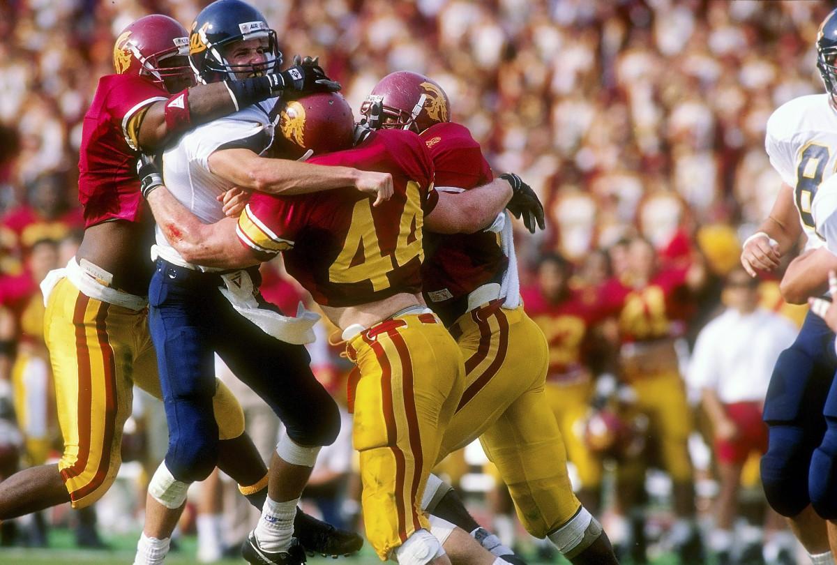 Webb (44) attacking Cal quarterback David Barr in 1992.