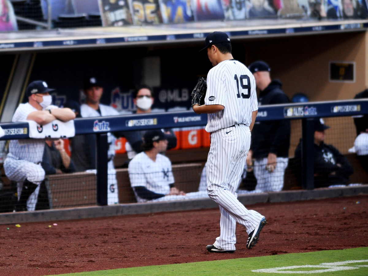 Oct 7, 2020; San Diego, California, USA; New York Yankees starting pitcher Masahiro Tanaka (19) walks to the dugout after being relieved in the fifth inning against the Tampa Bay Rays during game three of the 2020 ALDS at Petco Park.