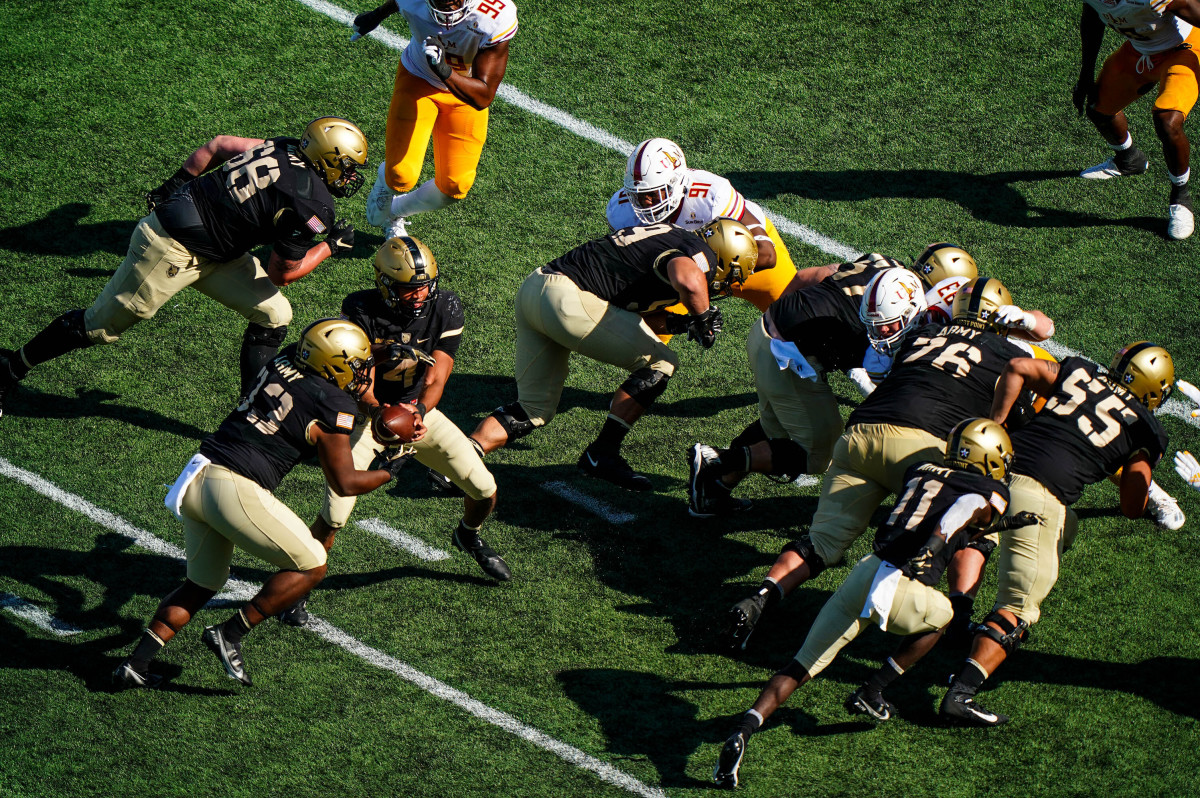 College football returned this fall—including this game between Army and Louisiana Monroe—amid a pandemic; experts predict that schools and the NCAA will face future litigation over not just head injuries, but also the coronavirus.