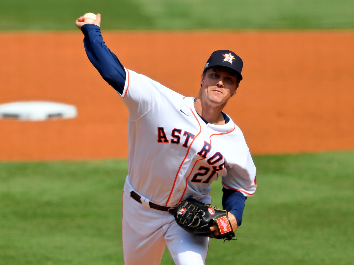 Oct 8, 2020; Los Angeles, California, USA; Houston Astros starting pitcher Zack Greinke (21) pitches against the Oakland Athletics during the first inning during game four of the 2020 ALDS at Dodger Stadium.