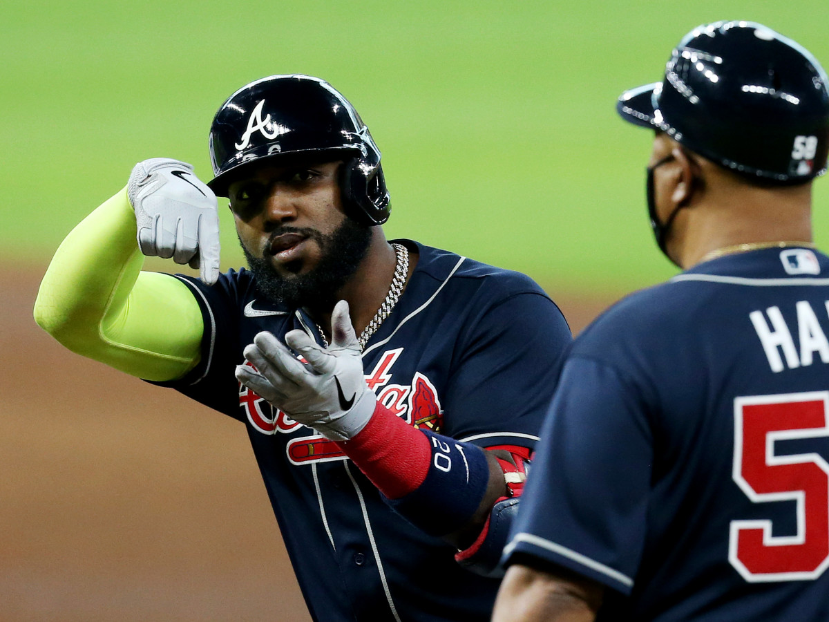 Oct 8, 2020; Houston, Texas, USA; Atlanta Braves designated hitter Marcell Ozuna (20) reacts after hitting a single against the Miami Marlins during the sixth inning of game three of the 2020 NLDS at Minute Maid Park.