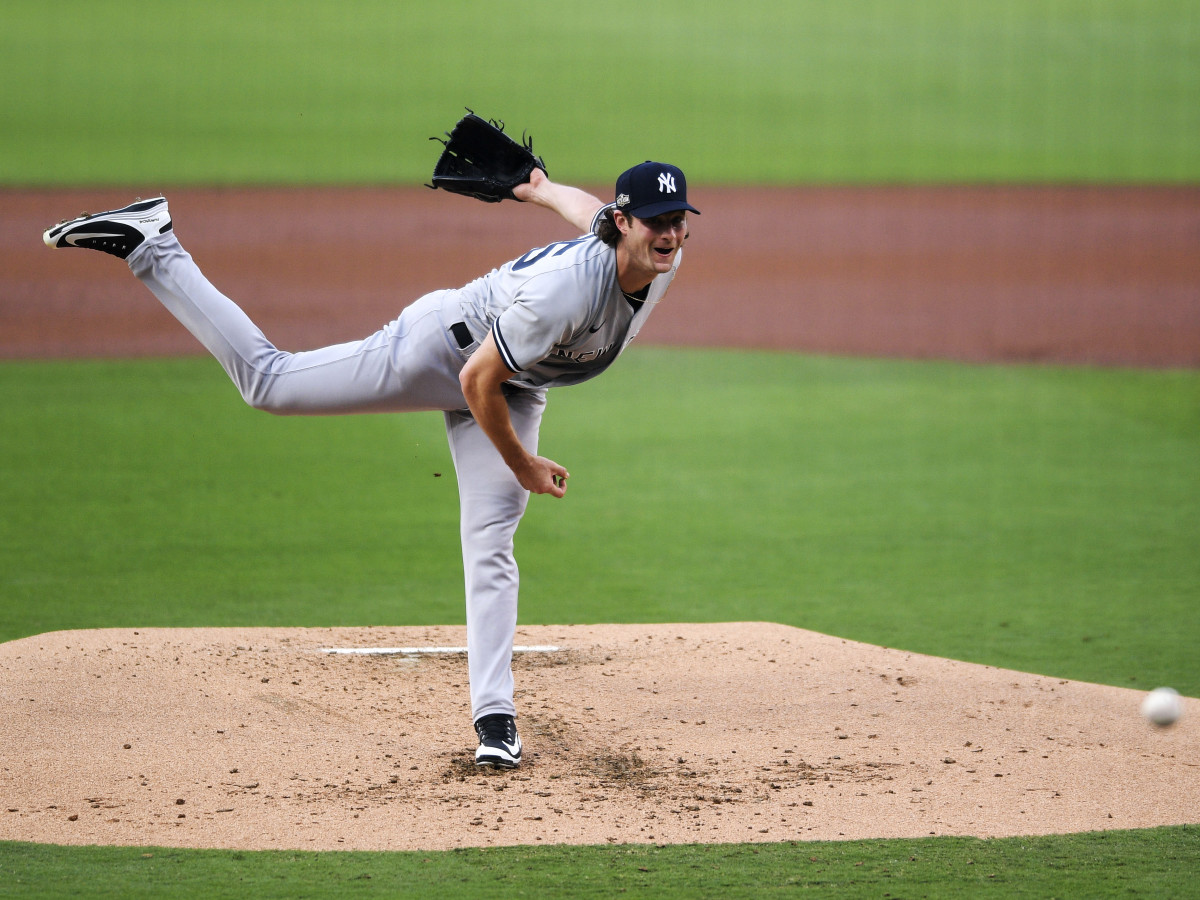 Oct 5, 2020; San Diego, California, USA; New York Yankees starting pitcher Gerrit  Cole (45) pitches against the Tampa Bay Rays during the first inning in game one of the 2020 ALDS at Petco Park.