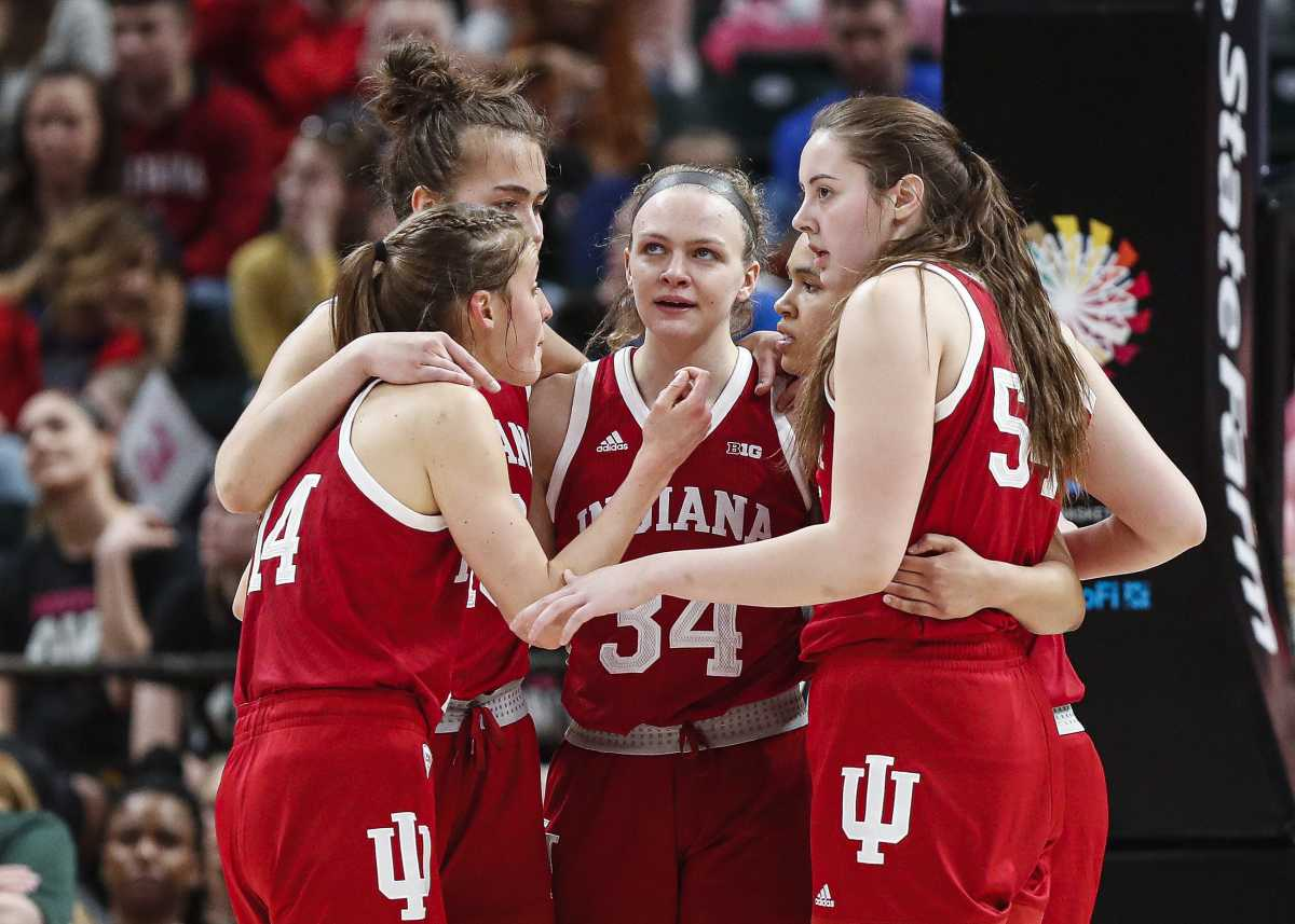 Indiana Hoosiers guard Grace Berger (34) gathered with her team during the Big Ten Semifinals at Bankers Life Fieldhouse, Indianapolis, March 7, 2020.