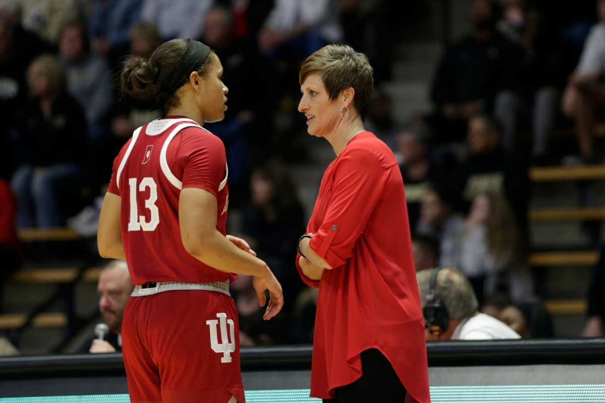 Indiana head coach Teri Moren and Indiana guard Jaelynn Penn (13) talk during the first quarter of a NCAA women's basketball game, Monday, Feb. 3, 2020 at Mackey Arena in West Lafayette.