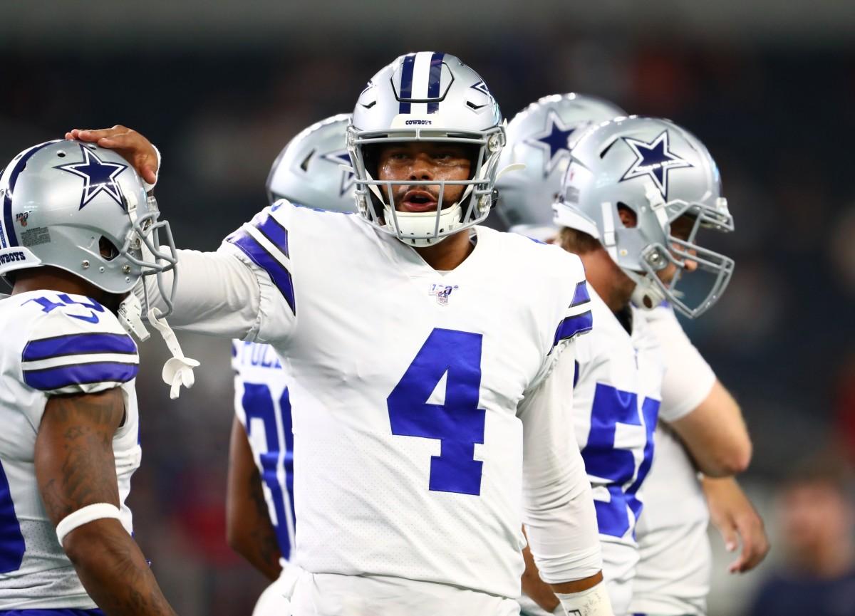 Aug 24, 2019; Arlington, TX, USA; Dallas Cowboys quarterback Dak Prescott (4) pats the helmet of receiver Tavon Austin (10) prior to the game against the Houston Texans at AT&T Stadium.
