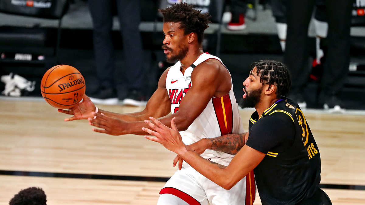 Miami Heat forward Jimmy Butler passes the ball against Los Angeles Lakers forward Anthony Davis