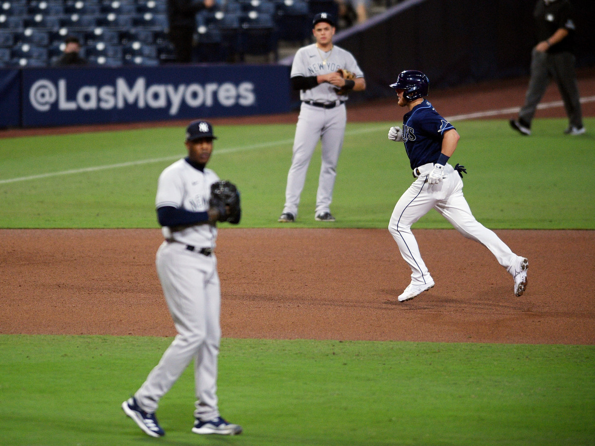 Oct 9, 2020; San Diego, California, USA; Tampa Bay Rays first baseman Michael Brosseau (43) runs the bases after hitting a home run (right) against New York Yankees relief pitcher Aroldis Chapman (left) during the eighth inning of game five of the 2020 ALDS at Petco Park.