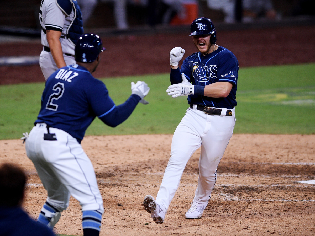 Oct 9, 2020; San Diego, California, USA; Tampa Bay Rays first baseman Michael Brosseau (43) celebrates with designated hitter Yandy Diaz (2) after hitting a home run against the New York Yankees during the eighth inning of game five of the 2020 ALDS at Petco Park.
