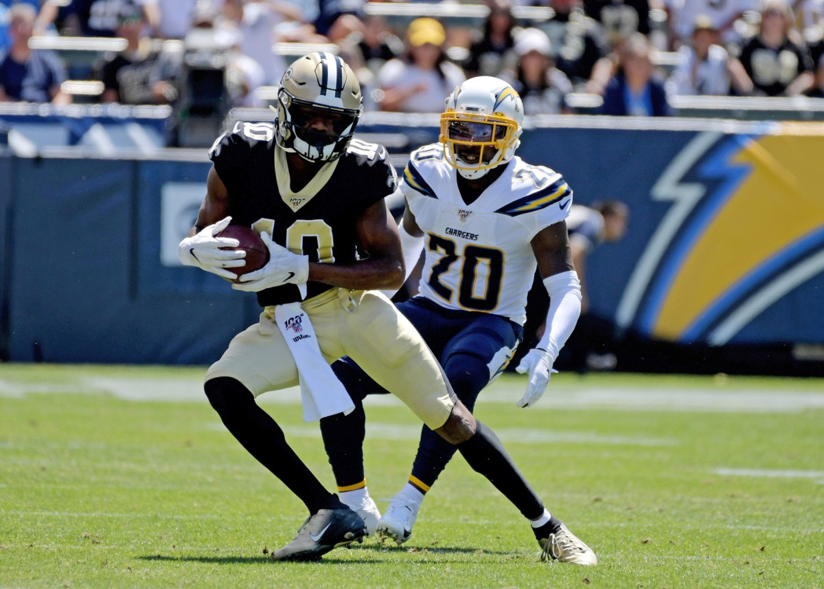 Aug 18, 2019; Carson, CA, USA; New Orleans Saints wide receiver Tre'Quan Smith (10) carries the ball past Los Angeles Chargers defensive back Desmond King (20) during the first half at Dignity Health Sports Park. Mandatory Credit: Kirby Lee-USA TODAY