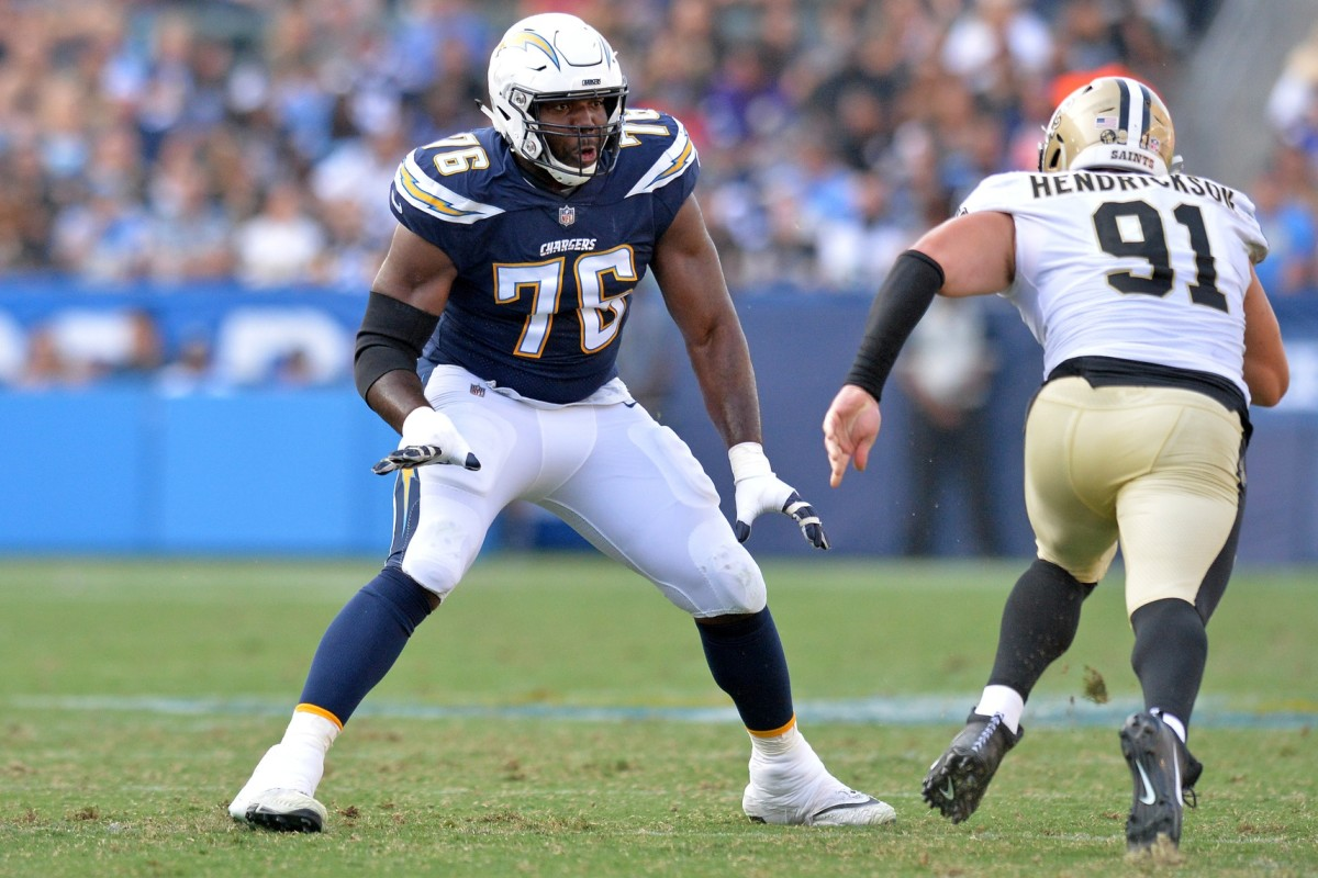 Aug 25, 2018; Carson, CA, USA; Los Angeles Chargers offensive tackle Russell Okung (76) works against New Orleans Saints defensive end Trey Hendrickson (91) at StubHub Center. Mandatory Credit: Jake Roth-USA TODAY Sports