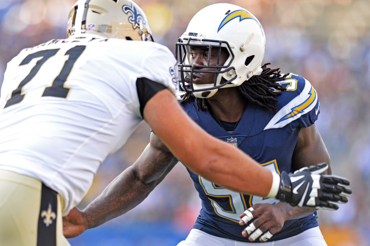 Aug 25, 2018; Carson, CA, USA; Los Angeles Chargers defensive end Melvin Ingram (54) works against New Orleans Saints offensive tackle Ryan Ramczyk (71) during the first quarter at StubHub Center. Mandatory Credit: Jake Roth-USA TODAY