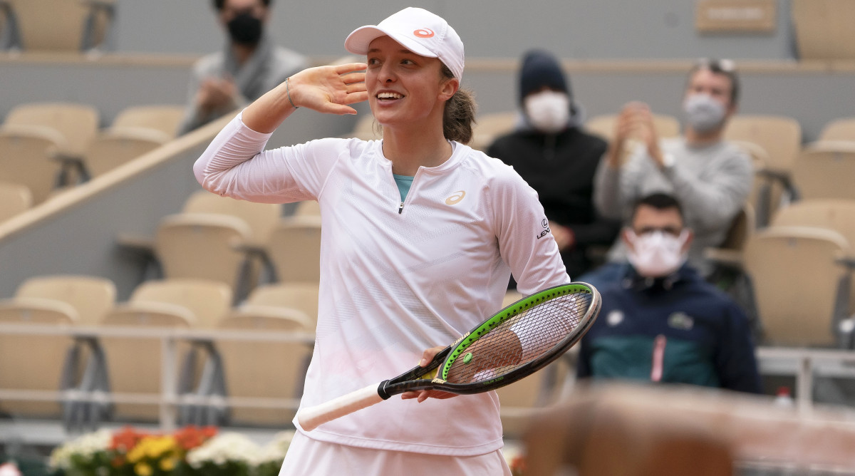 Oct 8, 2020; Paris, France; Iga Swiatek (POL) celebrates match point during her match against Nadia Podoroska (ARG) on day 12 at Stade Roland Garros.