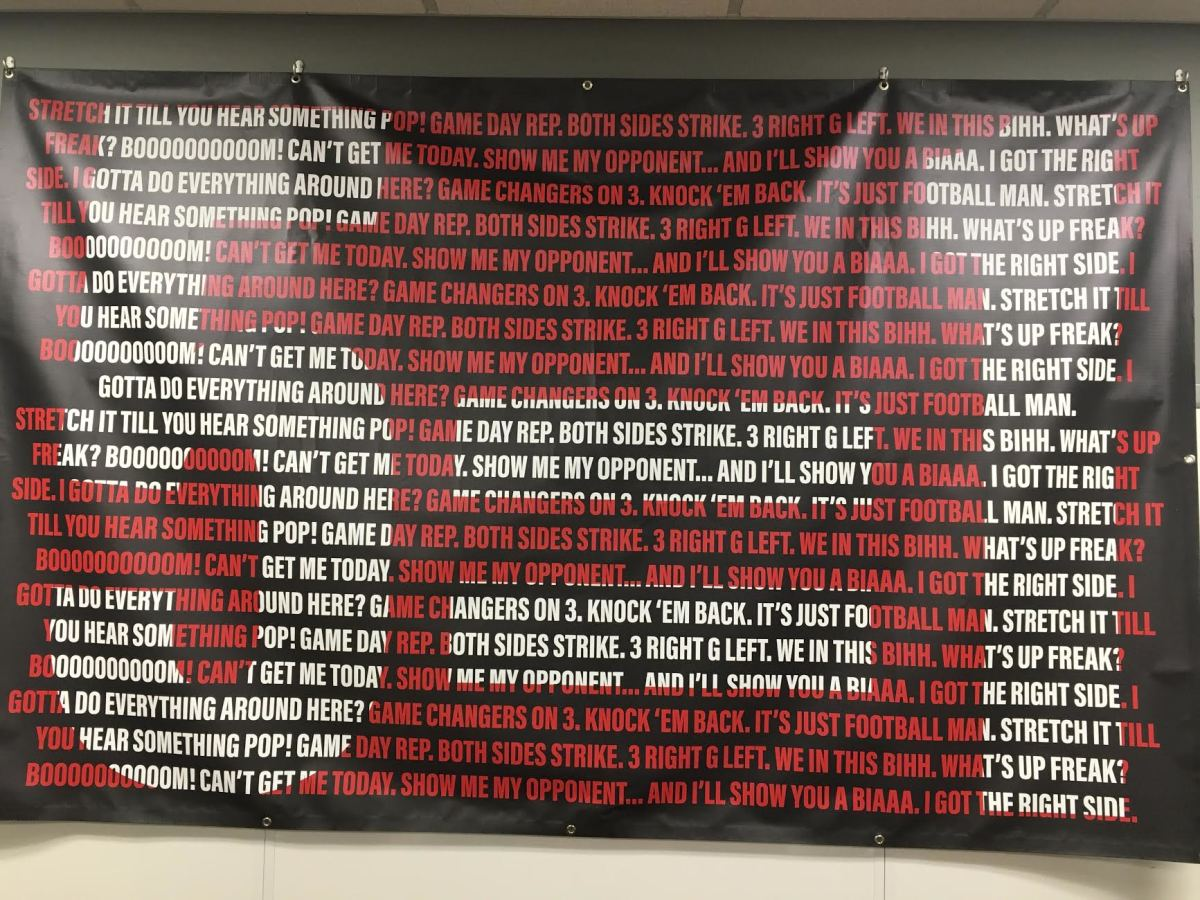 DJ Looney's most common quotes are on the wall of the program's offensive line meeting room.