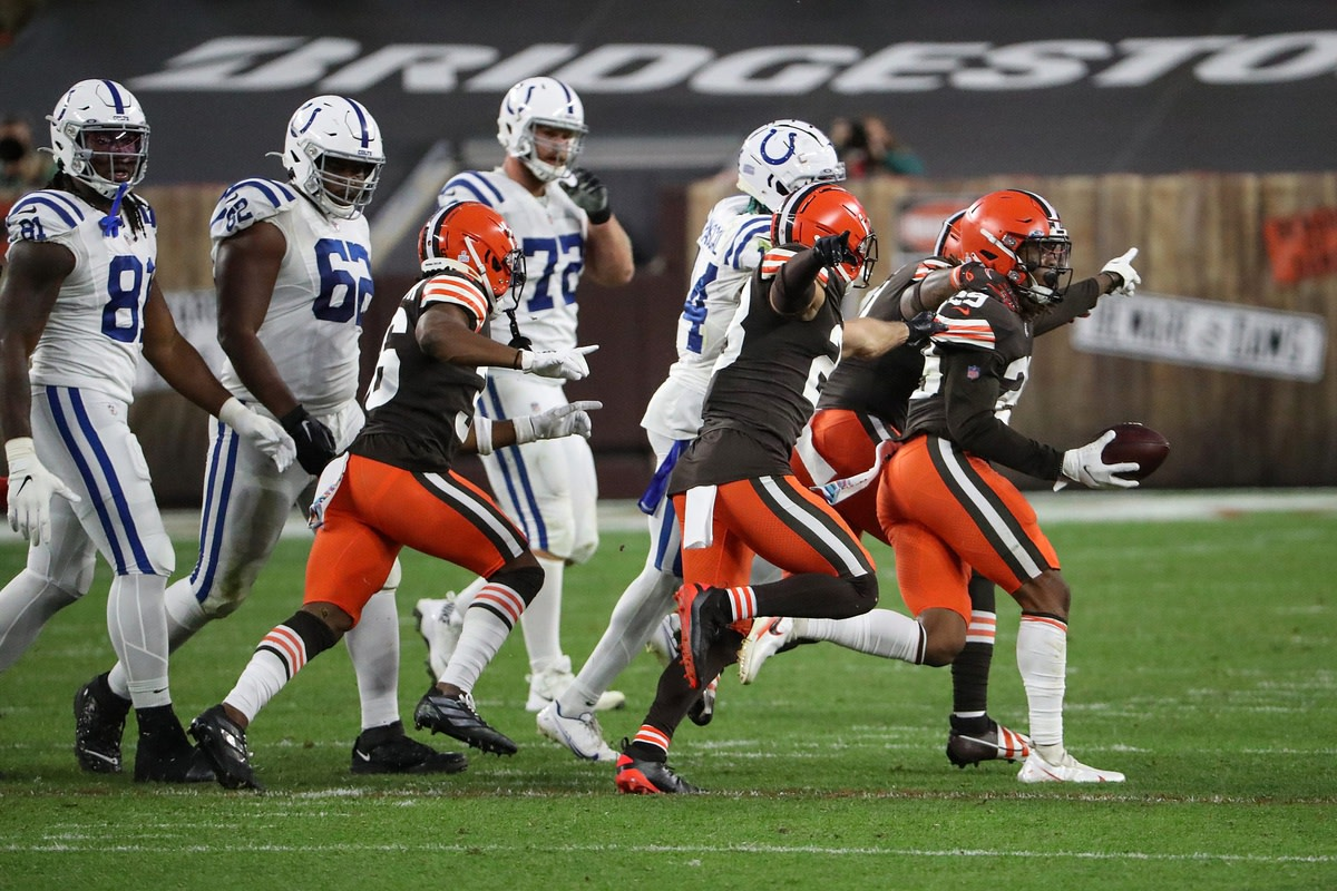The Cleveland Browns defense celebrates a second interception of quarterback Philip Rivers in the Indianapolis Colts' 32-23 road loss on Sunday.