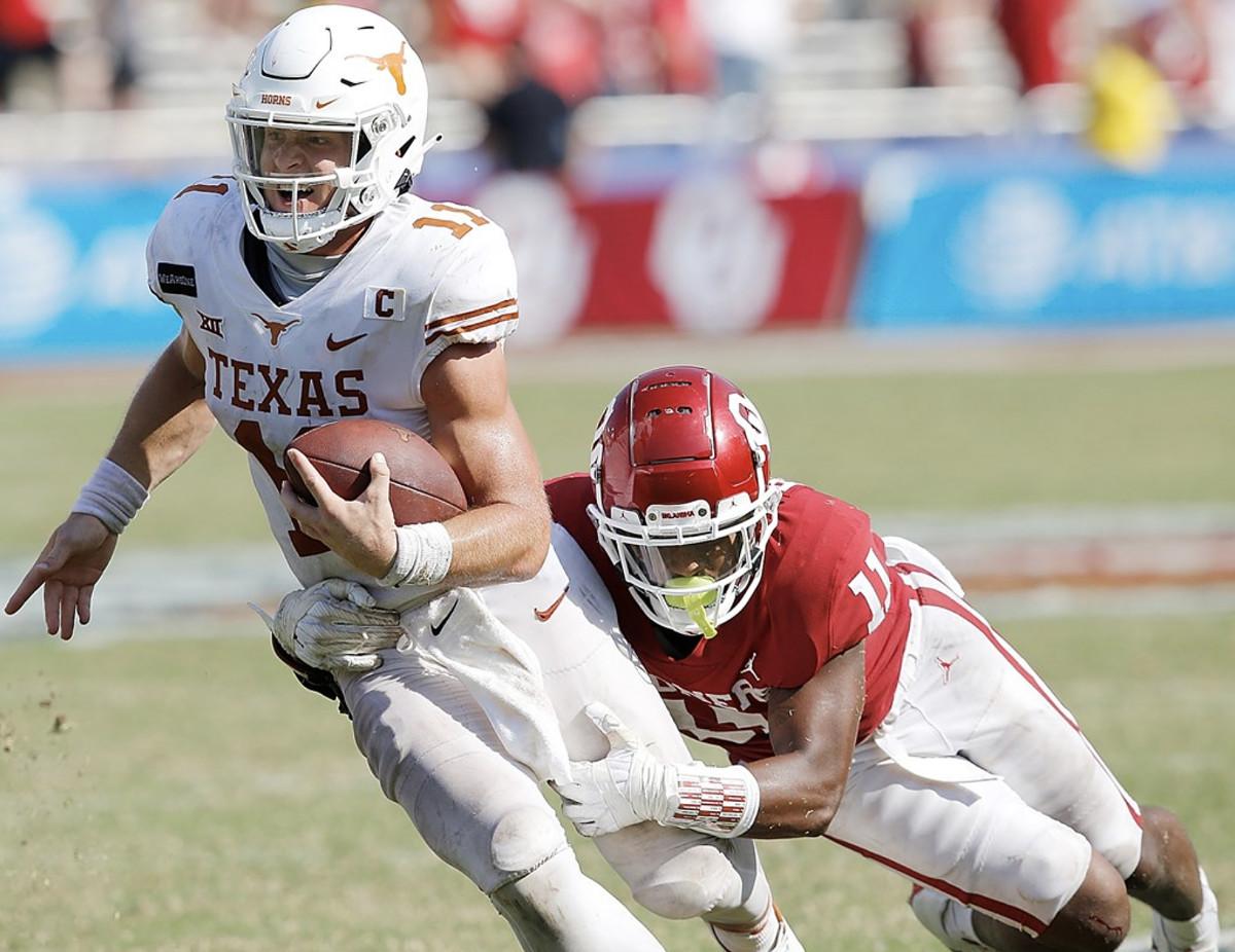 Oklahoma's Nik Bonitto tackling Texas' Sam Ehlinger
