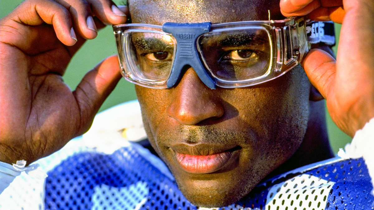 Portrait of Colts running back Eric Dickerson adjusting his goggles