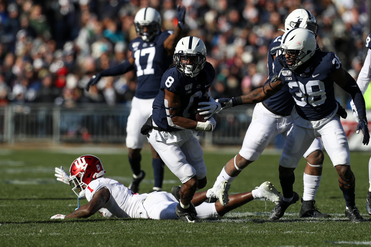 Penn State Nittany Lions cornerback Marquis Wilson (8) runs with the ball after a fumble recovery while Indiana Hoosiers wide receiver Whop Philyor (1) reacts during the second quarter at Beaver Stadium.