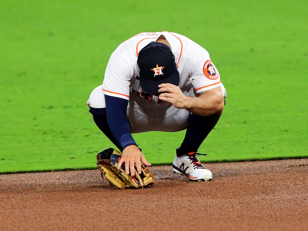 Oct 13, 2020; San Diego, California, USA; Houston Astros second baseman Jose Altuve (27) reacts after committing an error against the Tampa Bay Rays during the sixth inning in game three of the 2020 ALCS at Petco Park.