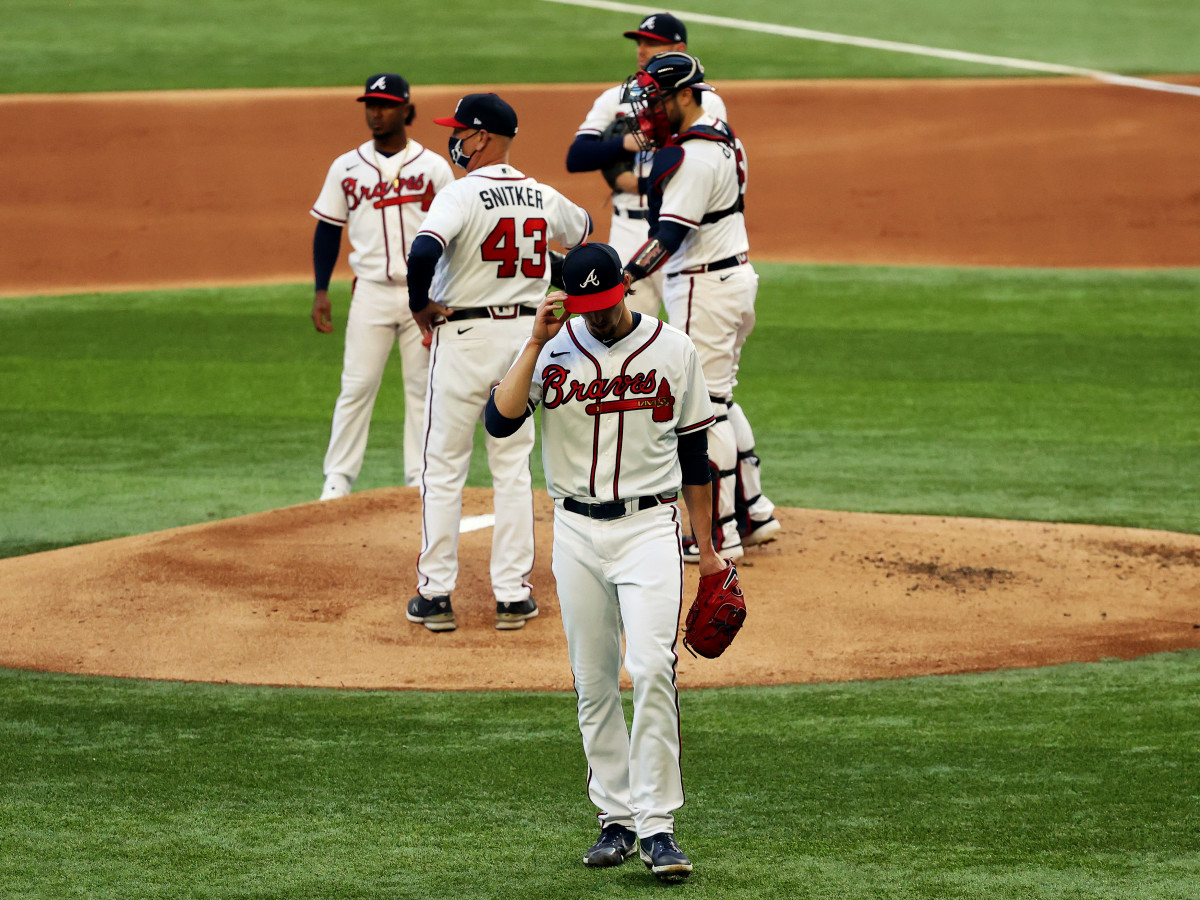Oct 14, 2020; Arlington, Texas, USA; Atlanta Braves starting pitcher Kyle Wright (30) reacts after being removed from the game by manager Brian Snitker (43) during the first inning of game three of the 2020 NLCS against the Los Angeles Dodgers at Globe Life Field.