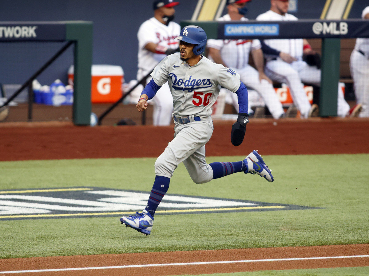 Oct 14, 2020; Arlington, Texas, USA; Los Angeles Dodgers right fielder Mookie Betts (50) scores on a hit by shortstop Corey Seager against the Atlanta Braves during the first inning of game three of the 2020 NLCS at Globe Life Field.