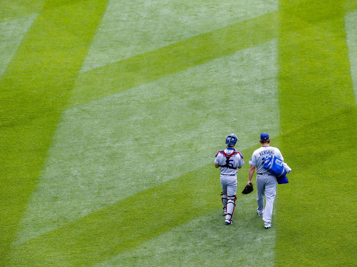 Clayton Kershaw walking with a teammate