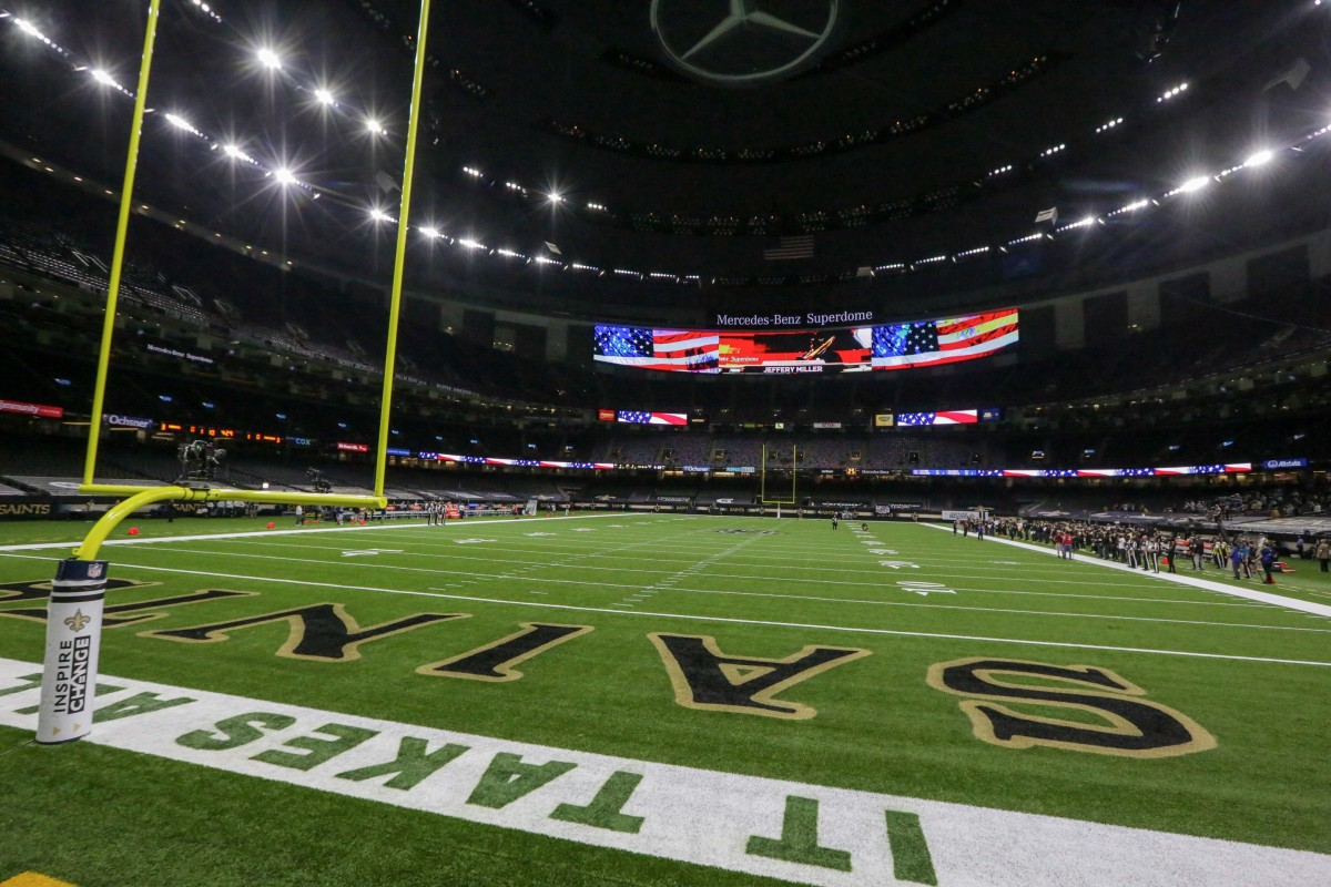 Sep 27, 2020; New Orleans, Louisiana, USA; A general view for the playing of the national anthem with the Green Bay Packers sideline empty prior to kickoff against the New Orleans Saints at the Mercedes-Benz Superdome. Man
