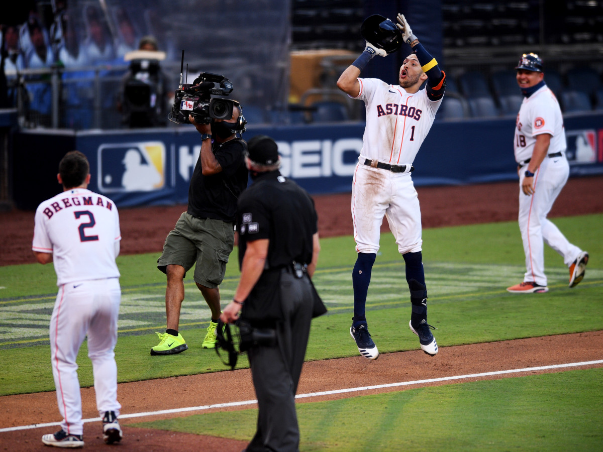 Oct 15, 2020; San Diego, California, USA; Houston Astros shortstop Carlos Correa (1) celebrates with teammates after hitting a solo home run to defeat the Tampa Bay Rays in the ninth inning during game five of the 2020 ALCS at Petco Park.