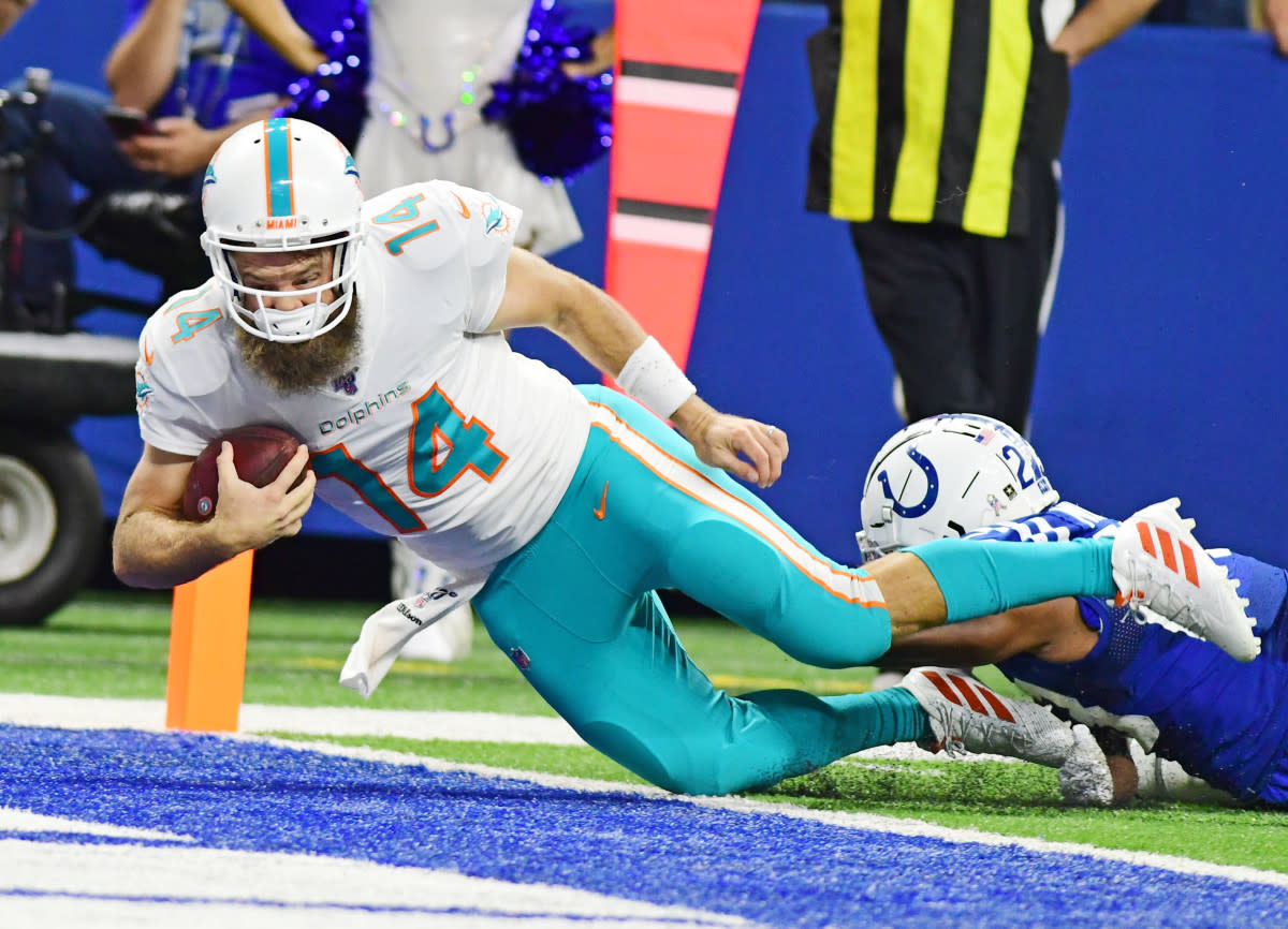 Dolphins quarterback Ryan Fitzpatrick dives past the goal line for a touchdown against the Colts. After starting a game in 2019, he became the 20th player to start for the Dolphins since Hall of Famer Dan Marino retired in 1999.