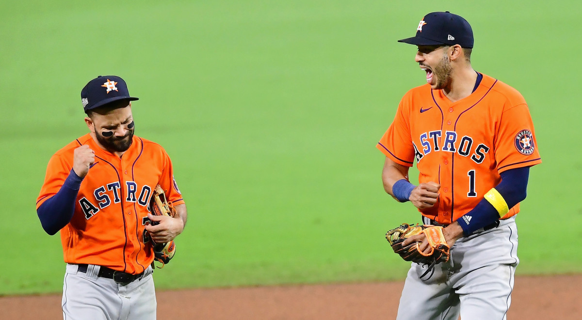 Houston Astros second baseman Jose Altuve (27) and shortstop Carlos Correa (1) celebrate their win over the Tampa Bay Rays after game six of the 2020 ALCS at Petco Park. The Houston Astros won 7-4.