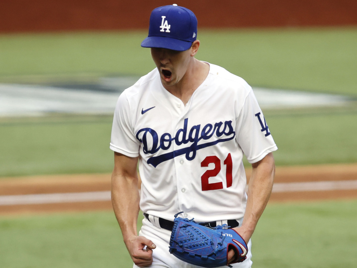 Los Angeles Dodgers starting pitcher Walker Buehler (21) reacts after a strike out in the sixth inning against the Atlanta Braves during game six of the 2020 NLCS at Globe Life Field.