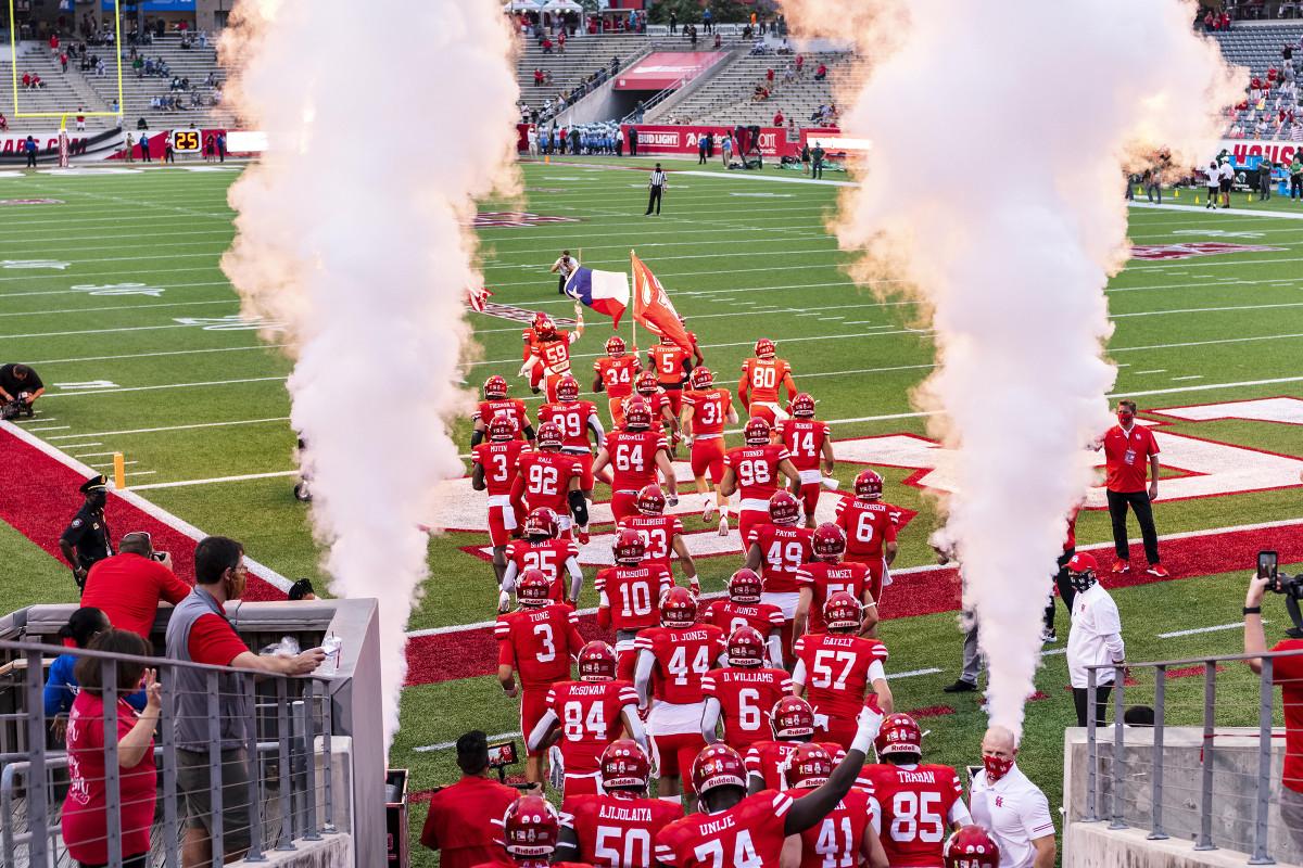 Houston football runs onto the field