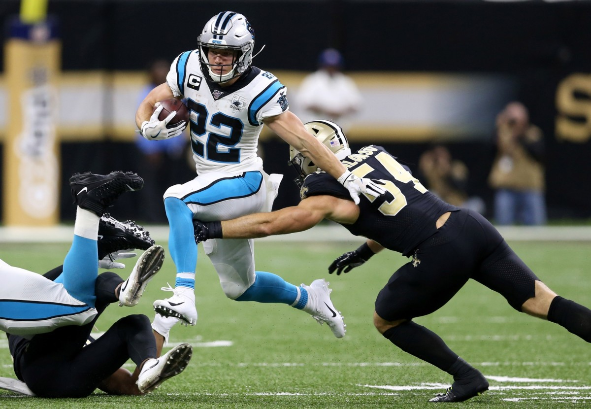 Nov 24, 2019; New Orleans, LA, USA; Carolina Panthers running back Christian McCaffrey (22) is defended by New Orleans Saints outside linebacker Kiko Alonso (54) in the second quarter at the Mercedes-Benz Superdome. Mandatory Credit: Chuck Cook-USA TODAY
