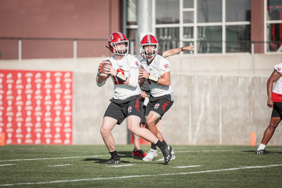 Utah quarterbacks Jake Bentley, left, and Cameron Rising, right, battle it out in practice for the starting quarterback job.