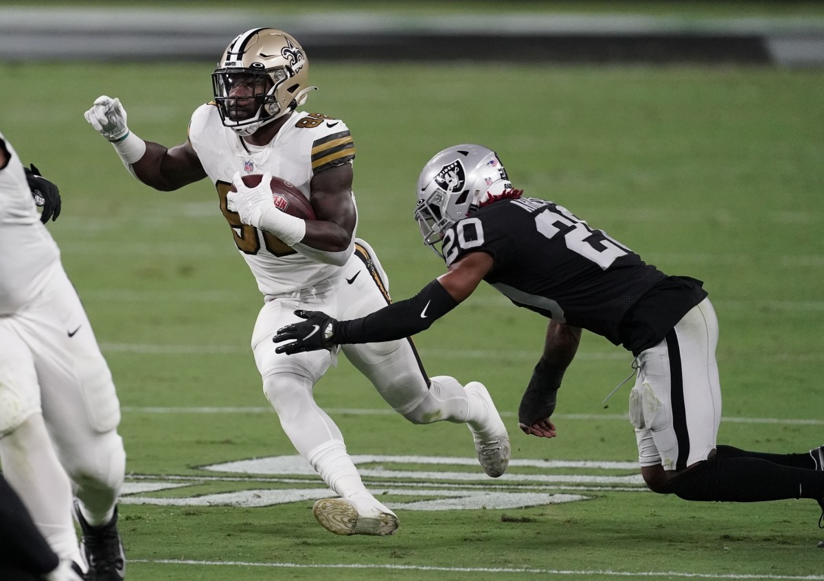 Sep 21, 2020; Paradise, Nevada, USA; New Orleans Saints running back Ty Montgomery (88) runs the ball against Las Vegas Raiders cornerback Damon Arnette (20) during the third quarter of a NFL game at Allegiant Stadium. Mandatory Credit: Kirby Lee-USA TODAY