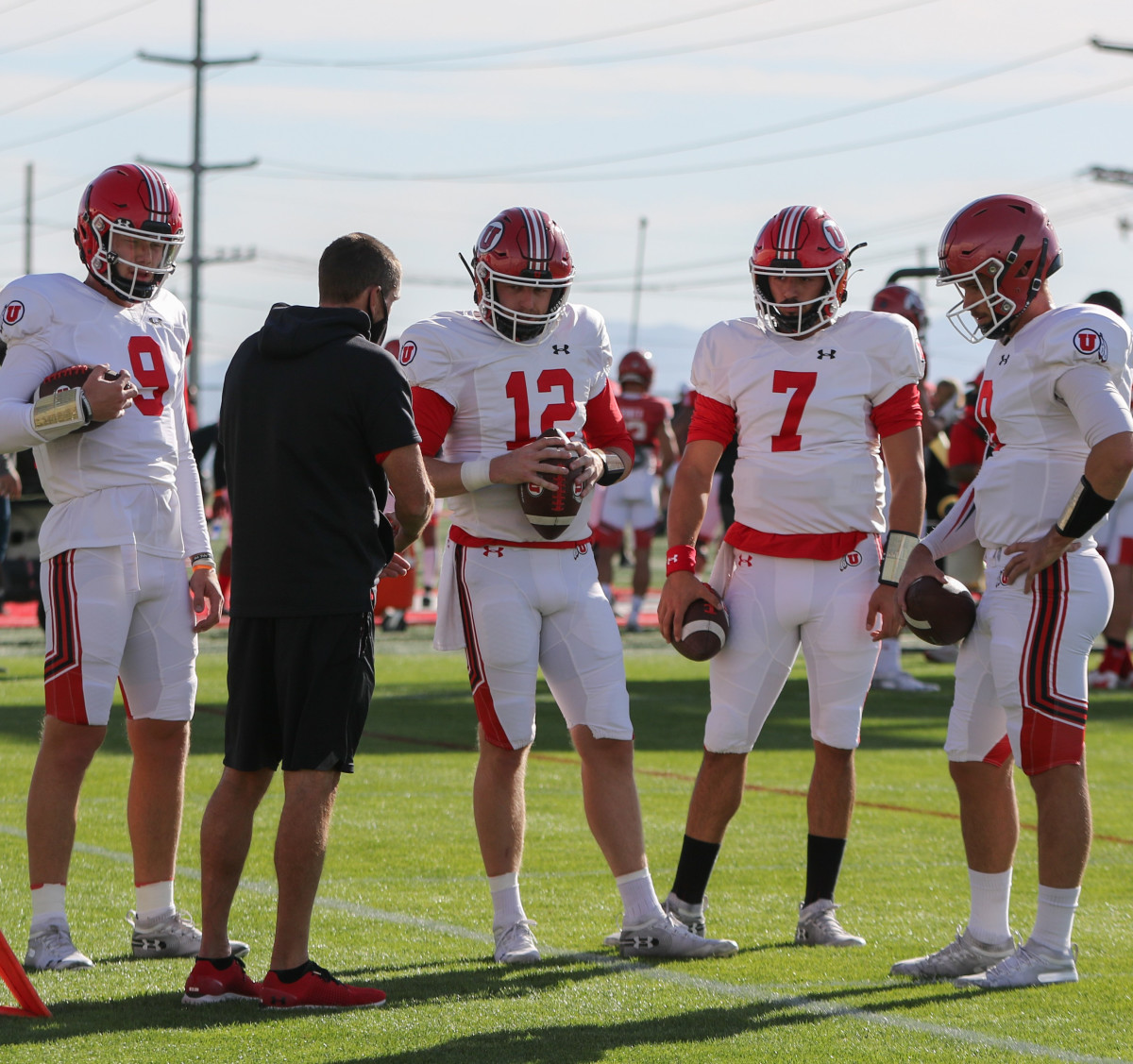 Utah quarterbacks (from left) Cooper Justice, Drew Lisk, Cameron Rising and Jake Bentley huddle together during a recent practice during fall camp.