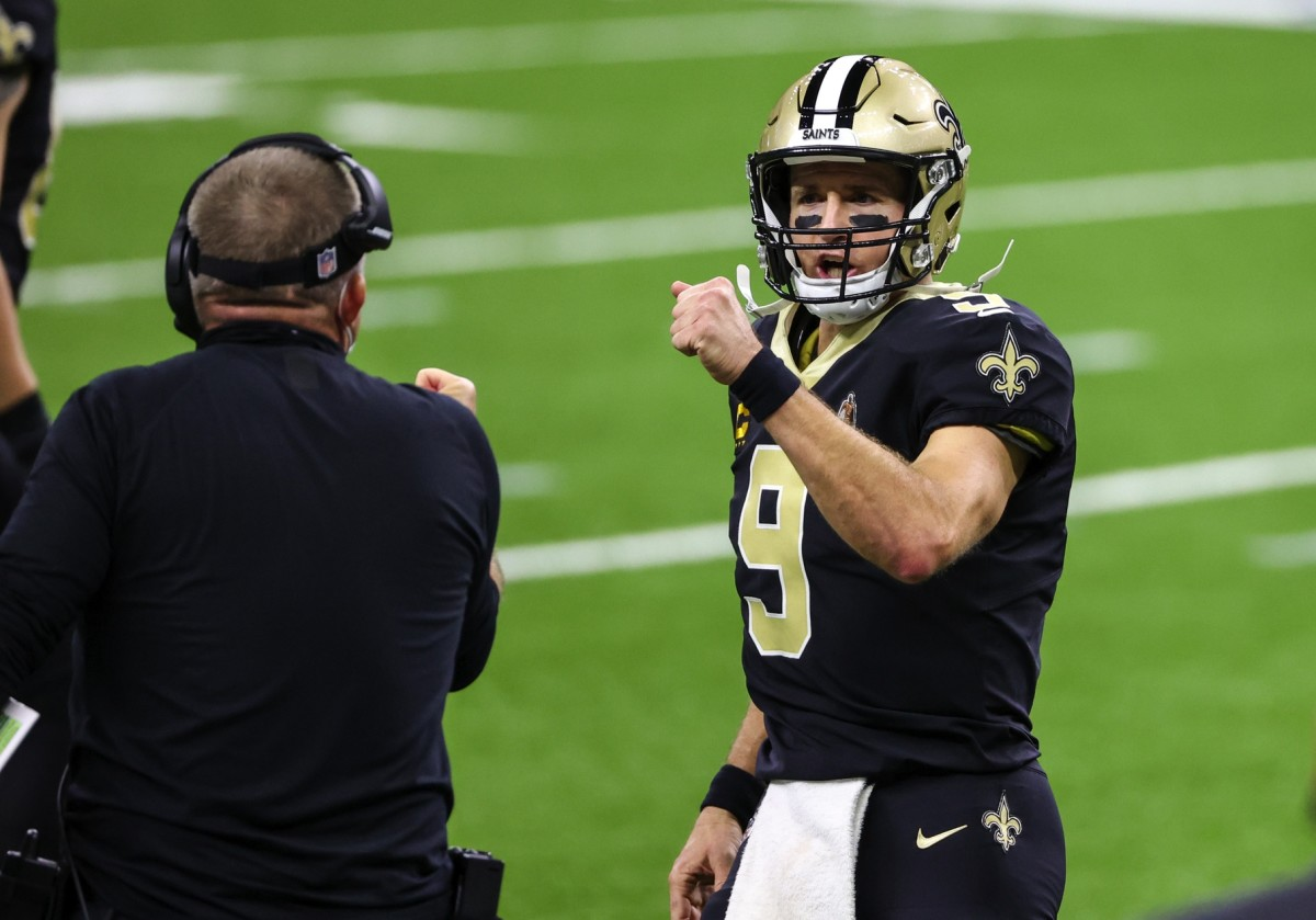 Sep 27, 2020; New Orleans, Louisiana, USA; New Orleans Saints quarterback Drew Brees (9) celebrates with head coach Sean Payton after a touchdown against the Green Bay Packers during the second quarter at the Mercedes-Benz Superdome. Mandatory Credit: Derick E. Hingle-USA TODAY Sports