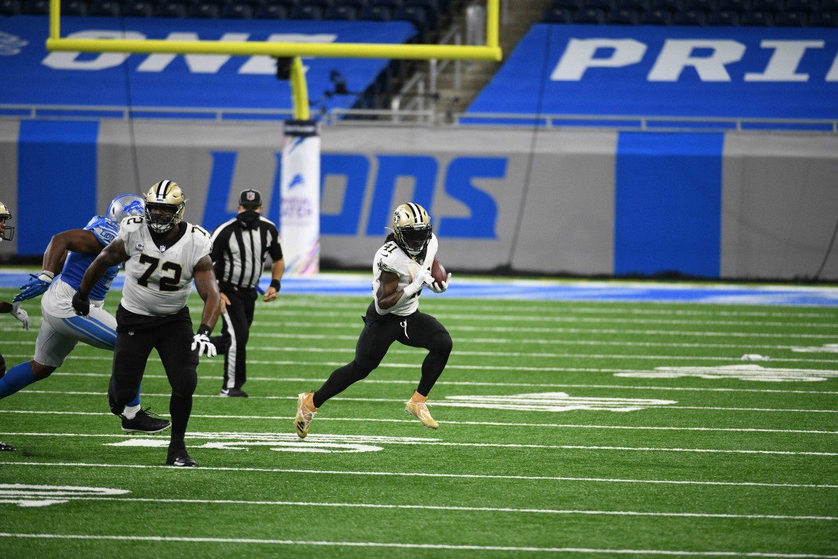 Oct 4, 2020; Detroit, Michigan, USA; New Orleans Saints running back Alvin Kamara (41) runs the ball during the fourth quarter against the Detroit Lions at Ford Field. Mandatory Credit: Tim Fuller-USA TODAY