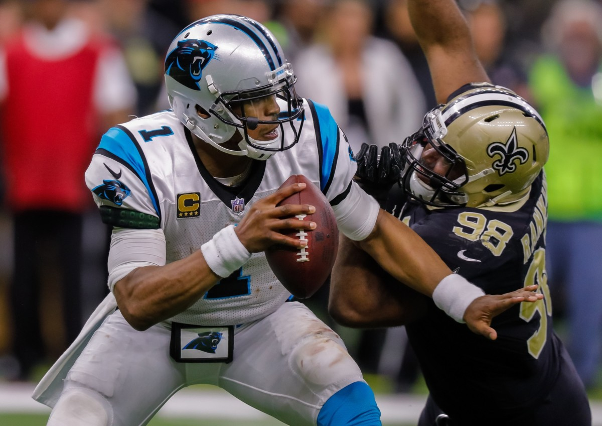 Jan 7, 2018; New Orleans, LA, USA; Carolina Panthers quarterback Cam Newton (1) avoids the tackle of New Orleans Saints defensive tackle Sheldon Rankins (98) in the fourth quarter in the NFC Wild Card playoff football game at Mercedes-Benz Superdome. Mandatory Credit: Stephen Lew-USA TODAY