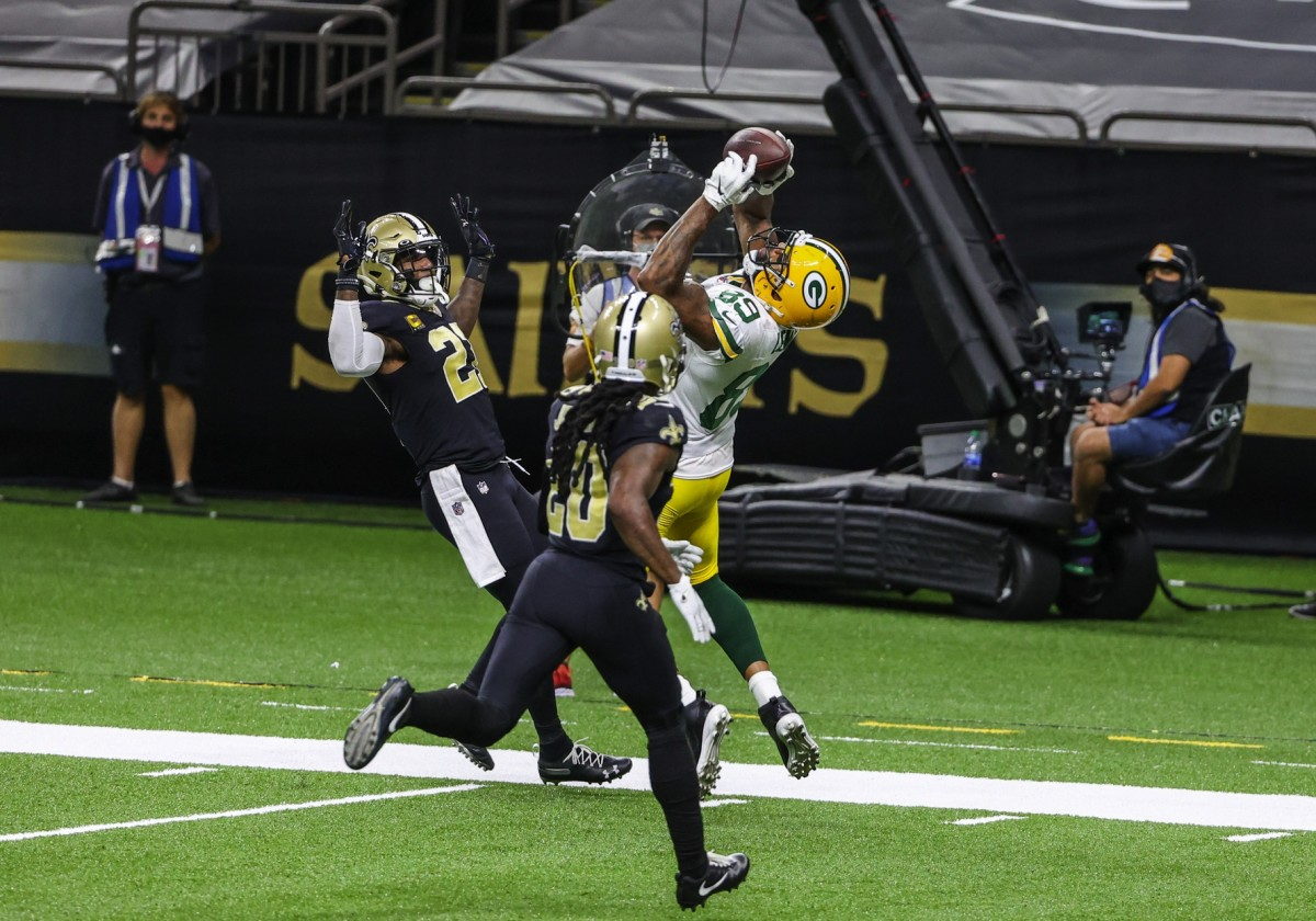 Sep 27, 2020; New Orleans, Louisiana, USA; Green Bay Packers tight end Marcedes Lewis (89) catches a touchdown over New Orleans Saints cornerback Janoris Jenkins (20) and safety Malcolm Jenkins (27) during the second half at the Mercedes-Benz Superdome. Mandatory Credit: Derick E. Hingle-USA TODAY