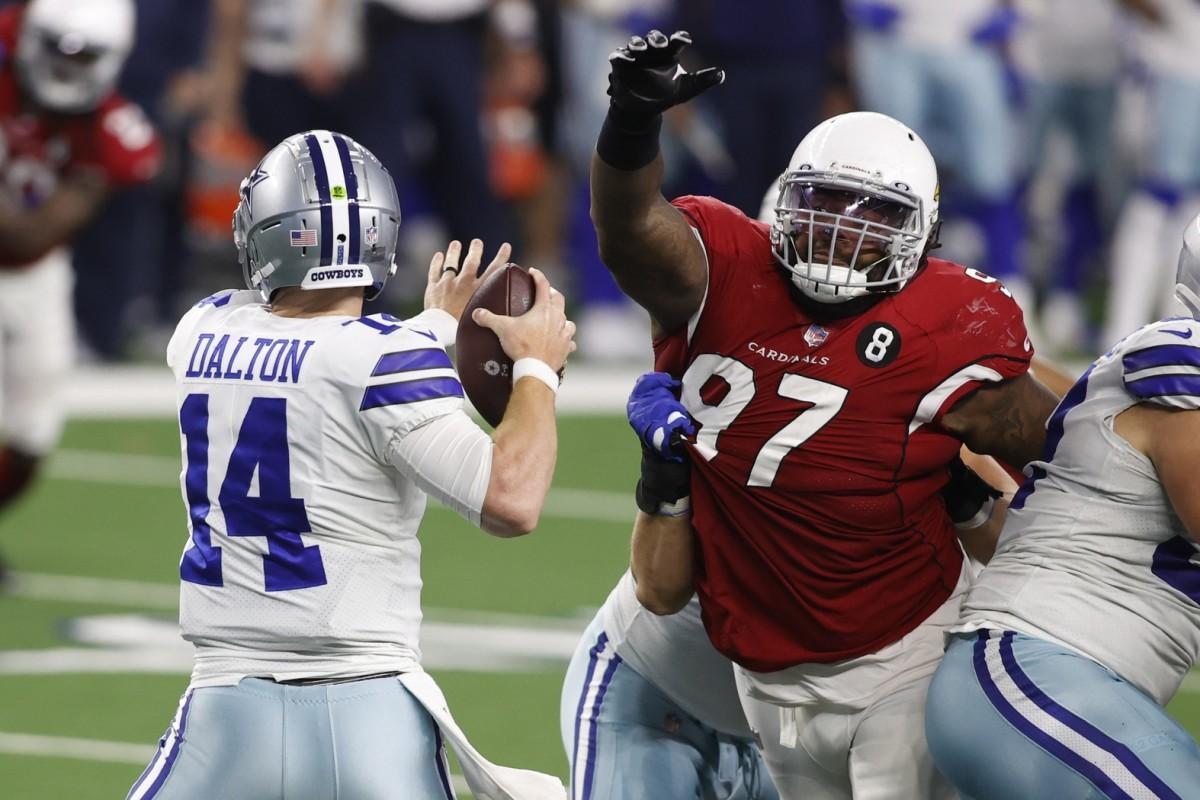 Arizona Cardinals defensive end Jordan Phillips (97) rushes Dallas Cowboys quarterback Andy Dalton (14) in the third quarter at AT&T Stadium.