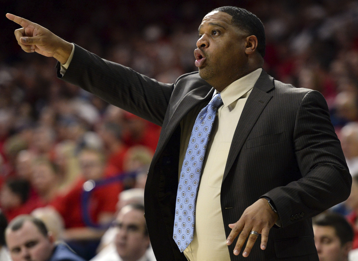 Arizona Wildcats assistant coach Book Richardson signals during the second half against the New Mexico Lobos at McKale Center. Arizona won 77-46.
