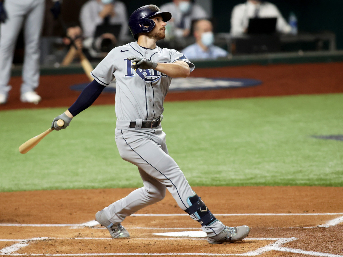 Oct 21, 2020; Arlington, Texas, USA; Tampa Bay Rays second baseman Brandon Lowe (8) connects for a solo home run in the 1st inning against the Los Angeles Dodgers in game two of the 2020 World Series at Globe Life Field.