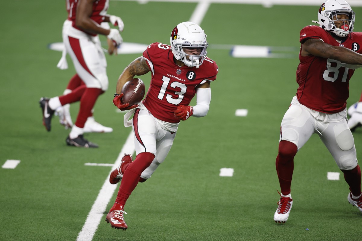 Arizona Cardinals wide receiver Christian Kirk (13) runs for a touchdown against the Dallas Cowboys in the second quarter at AT&T Stadium.