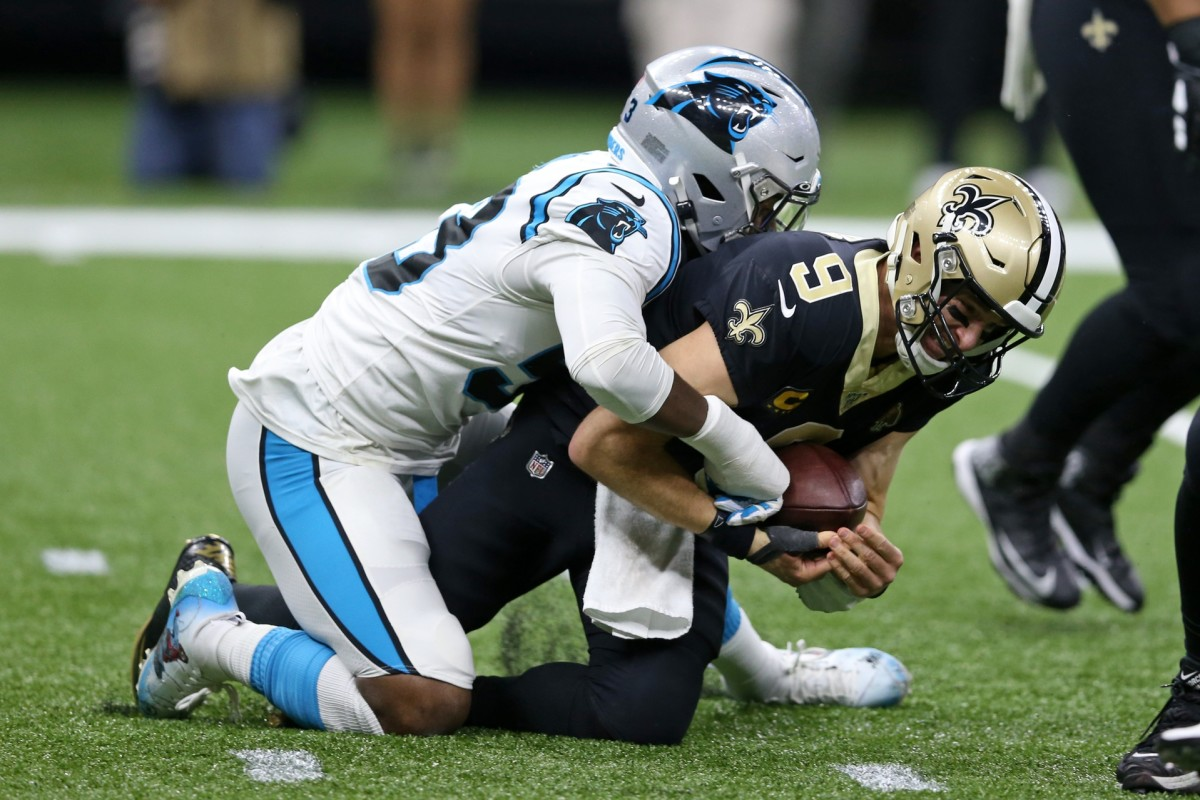 Nov 24, 2019; New Orleans, LA, USA; Carolina Panthers linebacker Brian Burns (53) sacks New Orleans Saints quarterback Drew Brees (9) in the second half at the Mercedes-Benz Superdome. The Saints won, 34-31. Mandatory Credit: Chuck Cook-USA TODAY