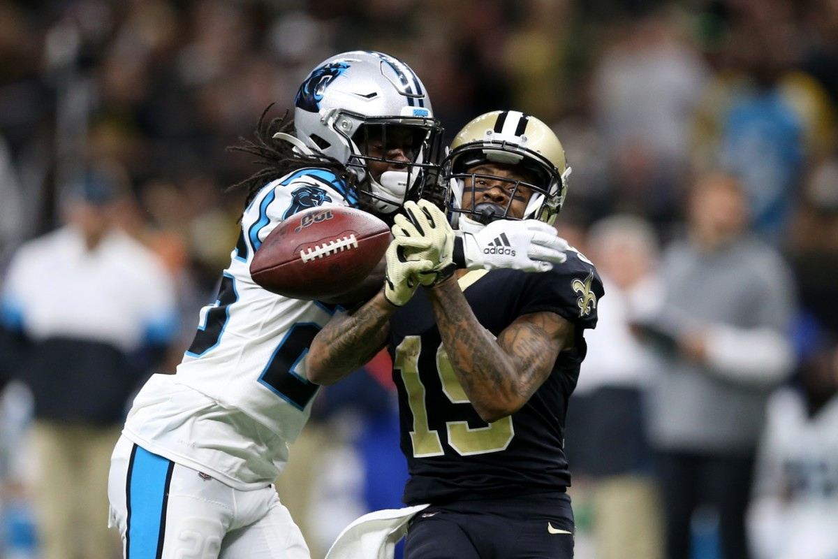 Nov 24, 2019; New Orleans, LA, USA; New Orleans Saints wide receiver Ted Ginn (19) can't hold onto the ball with Carolina Panthers cornerback Donte Jackson (26) defending in the second half at the Mercedes-Benz Superdome. The Saints won, 34-31. Mandatory Credit: Chuck Cook-USA TODAY Sports