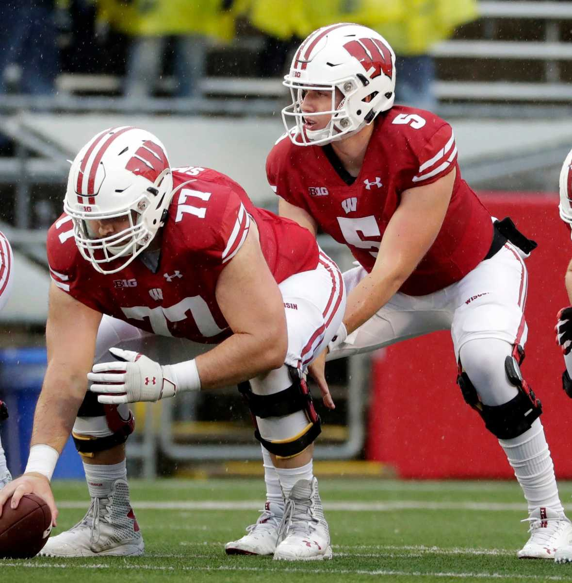 Wisconsin freshman quarterback Graham Mertz scans over the Kent State defense before taking a snap during the fourth quarter of a 2019 game.