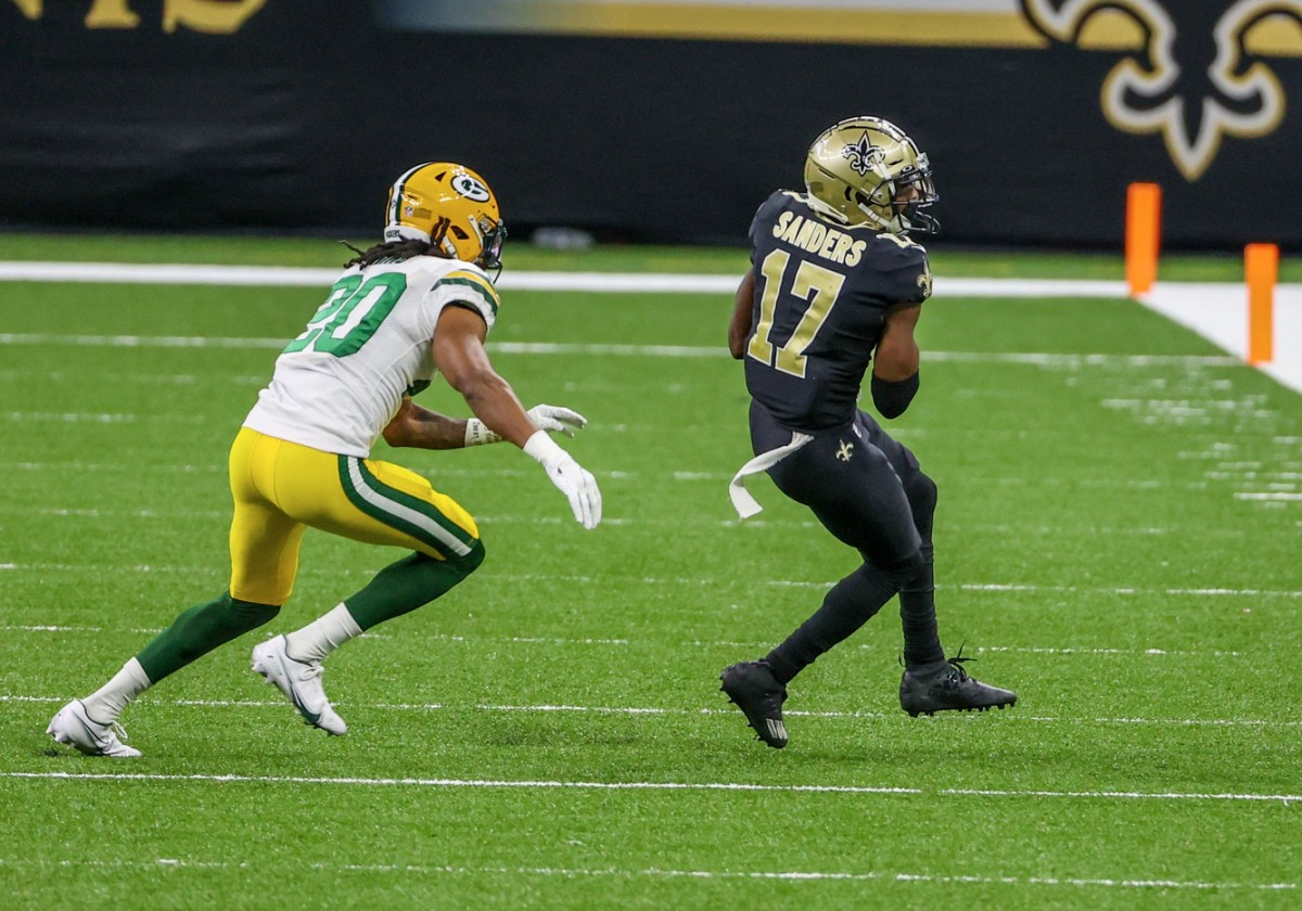 Sep 27, 2020; New Orleans, Louisiana, USA; New Orleans Saints wide receiver Emmanuel Sanders (17) catches a pass as Green Bay Packers running back Jamaal Williams (30) defends during the second half at the Mercedes-Benz Superdome. Mandatory Credit: Derick E. Hingle-USA TODAY
